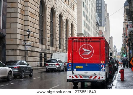 Montreal, Canada - November 6, 2018: Canada Post Logo On One Of Their Delivery Trucks In A Street Of
