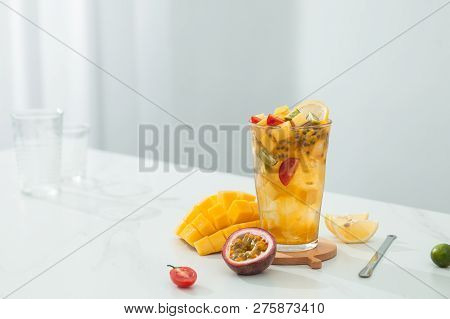 Mango Passion Fruit Tea In A Transparent Glass