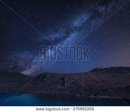 Stunning Vibrant Milky Way Composite Landscape Image Over Catbells Near Derwent Water In The Lake Di