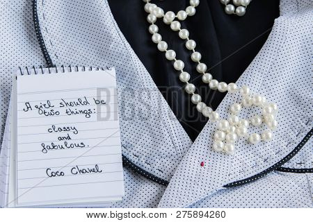 """Coco Chanel quotes written on a block note, pearl accessories and a classy jacket ,inspiration phrase """"A girl should be two things: classy and fabulous"""" poster"""