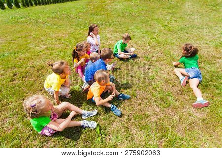 Top View Of Group Of Children Playing On Grass