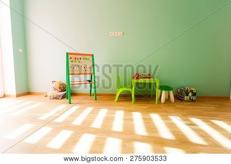 Modern Playroom For Children With Green Walls