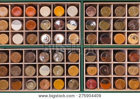 Shelf Made Of Cubic Cells Filled With Jars