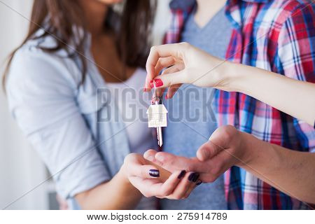 New Home. Funny Young Couple Enjoy And Celebrating Moving To New Home. Happy Couple At Empty Room Of