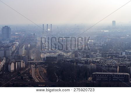 Misty Skyline Of Berlin With Freeway And Power Plant