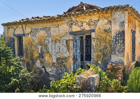 Ruined Abandoned Old Farmer Cottage In Greece
