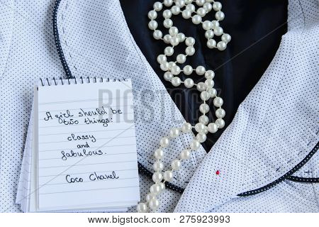 Coco Chanel Quotes Written On A Block Note, Pearl Accessories And A Classy Jacket ,inspiration Phras