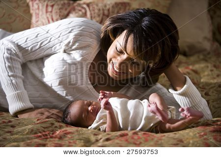 African American mother admiring her newborn child