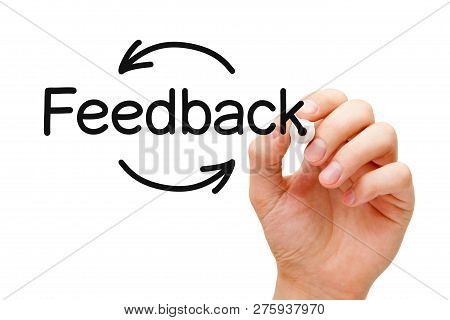 Hand Writing Feedback Cycle Arrows Concept With Black Marker On Transparent Wipe Board Isolated On W