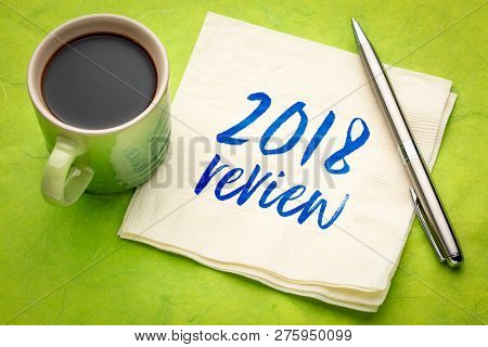 2018 review text - handwriting on a napkin with a cup of coffee