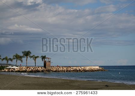 View Of A Pier With A Lifeguard Hut, The Mediterranean Sea And The Sky From An Empty Limassol Beach