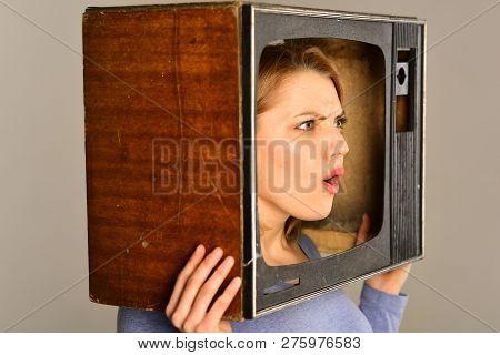 Watching Tv. Surprised Woman Watching Tv. Watching Tv Program. Watching Tv With Surprised Woman Hold