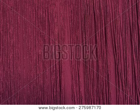 Maroon Fabric With Fringe. Close Up. Background