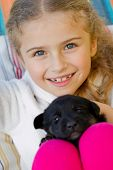 Best friends - happy girl with cute puppy in the garden poster