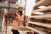 Latino Manual Worker With Forkift Pallet Stacker In Construction Site poster