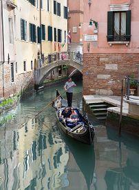 Venice/italy- April 16, 2018: An Unidentified  Caucasian Couple Having A Romantic Ride In Gondola.