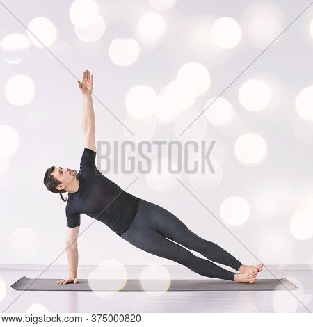 Man Practice Yoga. Pilates Training At Home. Dancer Workout. Side Plank Aerobic Pose. Fitness Wellne