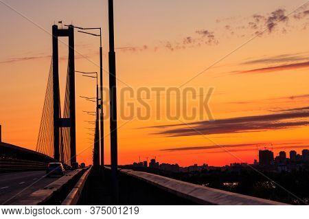 South Bridge Across The Dnieper River In Kiev, Ukraine At Sunset