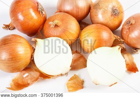Peeled And Unpeeled Onions On White Background, Concept Of Healthy Nutrition