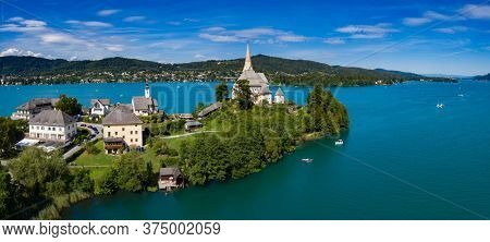 Scenic landscape in in the Alps, Tyrol, Austria in summer, Maria Wörth at lake of Worther See near Klagenfurt.
