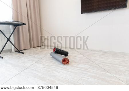 Yoga Mat And Foam Roller In Living Room At Home For Yoga Exercises