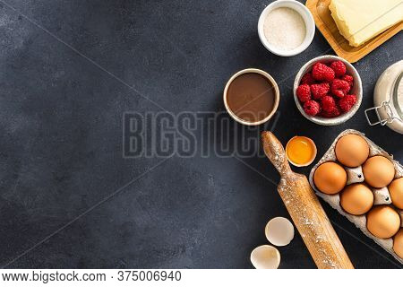 Ingredients For Cooking Raspberry And Chocolate Pie On Dark Background With Place For Text Bakery Ba