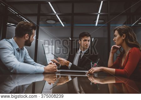 Lawyer Pointing At A Marital Contract To Spouses