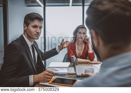 Lawyer Discussing With A Man Divorce Reasons