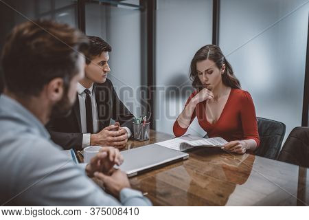 Spouses And Lawyer Trying To Resolve A Difficult Situation