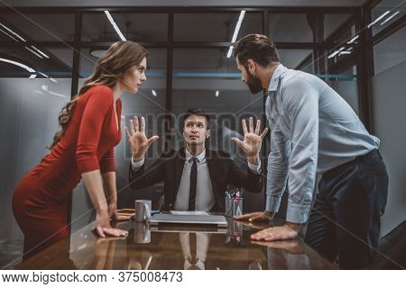 Lawyer Trying To Stop The Argument Between Spouses