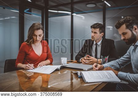 Spouses Signing Papers In The Lawyers Office