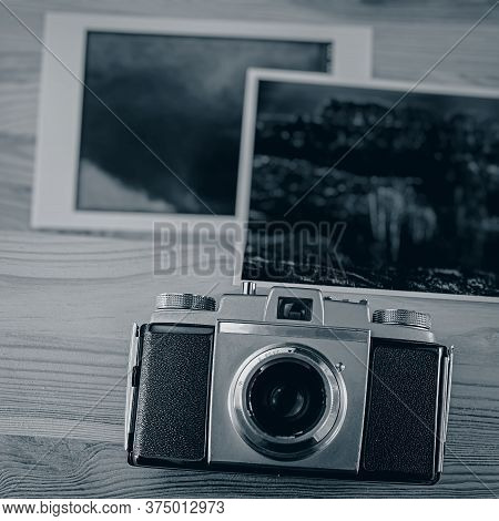 Vintage Analog Camera And Old Photographic Prints. Web Banner. Business Concept.