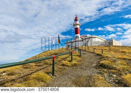 Loghthouse on a coast of Magdalena island, Chile