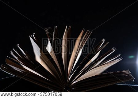 Vintage Open Book Glows In The Darkness. Concept Of Self-education, Knowledge And Intellect