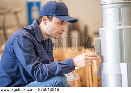 Engineer supervisor checking a vessel in a factory
