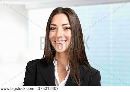 Portrait of a smiling cheerful business woman Bright background