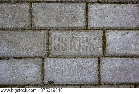 Simple Rectangular Paving Slabs. Gray Paving Tiles Details Close-up. The Texture Of Paving Tiles, Th