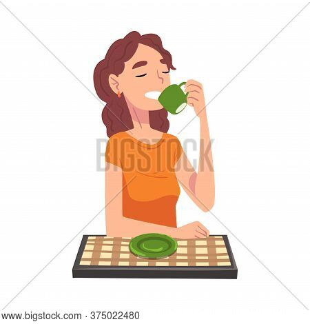 Young Woman Drinking Tea, Cheerful Girl Sitting At Table With Checkered Tablecloth Enjoying Eating O