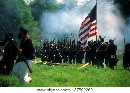 Union Infantry Line Fires On Advancing  Confederate Soldier
