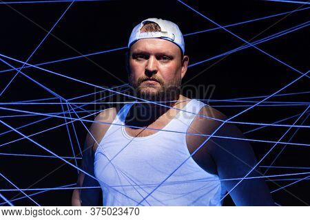 Image Of Stout Man With White Threads In Ultraviolet