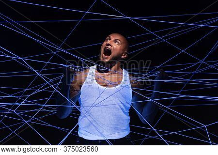 Photo Of Bald Screaming Man Tangled In White Threads In Ultraviolet