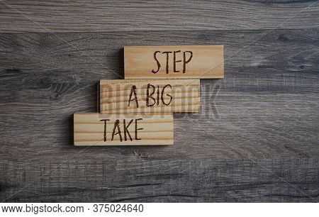Wooden Pieces With Message Take A Big Step On Wooden Background