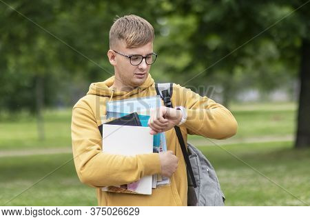 Handsome Young Guy, Busy University Or College Student Or Pupil With Books, Textbooks And Backpack I