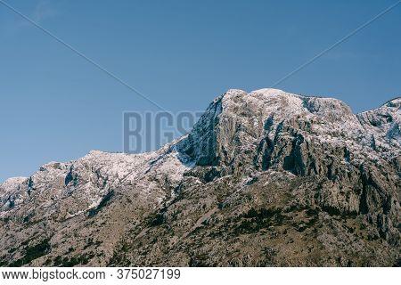 Snow-capped Mountain Peaks In Boka Kotorska. Winter In Montenegro In Kotor Bay.