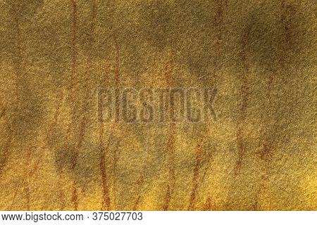 Texture Of Old Yellow And Ocher Paper, Closeup. Structure Of A Gold Cardboard. Abstract Art Backgrou