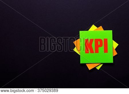 Kpi Is Written On A Dark Background On Bright Stickers. Business Concept