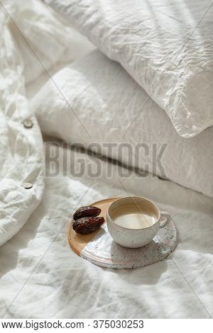 Cup Of Fresh Coffee In Bed On Ceramic Tray, Morning Mood. Linen Cotton Textile Bedclothes. Organic A