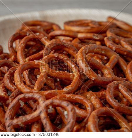 Pretzels On A Plate On The Kitchen Table. Snack On Beer. Salty Snack. Crispy Pretzels. Beer Snacks