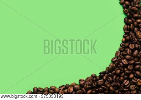 Semi-circular Corner Frame Made Of Many Coffee Beans. Isolated On A White Background, Copy Space For