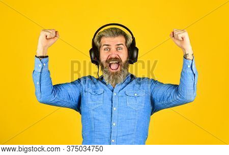 Feel Of Success. Man With Headset. Bearded Man Hipster In Headset. Listen Audio Book. Music Beat For